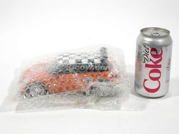 2007 Mini Cooper S diecast model car 1:24 scale die cast by Jada Toys - Orange Racing