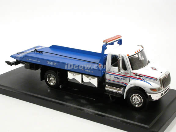 2008 International Durastar 4400 Flat Bed Tow Truck diecast model truck 1:24 scale by Jada Toys - Blue White