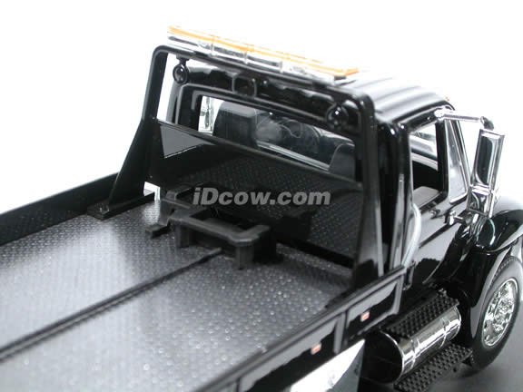2008 International Durastar 4400 Flat Bed Tow Truck diecast model truck 1:24 scale by Jada Toys - Black