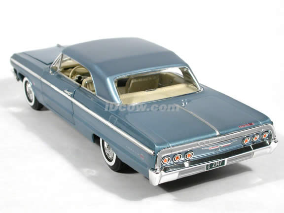 1964 Chevy Impala diecast model car 1:18 scale SS 409 by Ertl 1 of 2500 - Light Blue