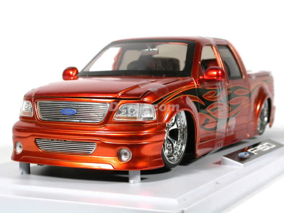 2003 Ford F-150 diecast model truck 1:18 scale die cast from Dub City Jada Toys - Orange Copper