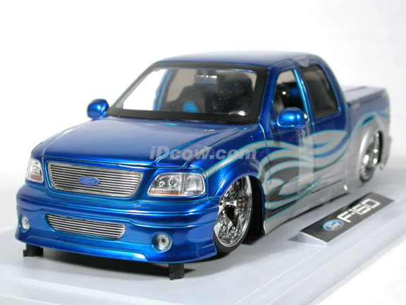2003 Ford F-150 diecast model truck 1:18 scale die cast from Dub City Jada Toys - Blue Silver