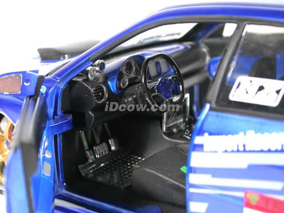 2004 Subaru WRX STi diecast model car 1:18 scale die cast from Import Racer Jada Toys - Candy Blue Purple