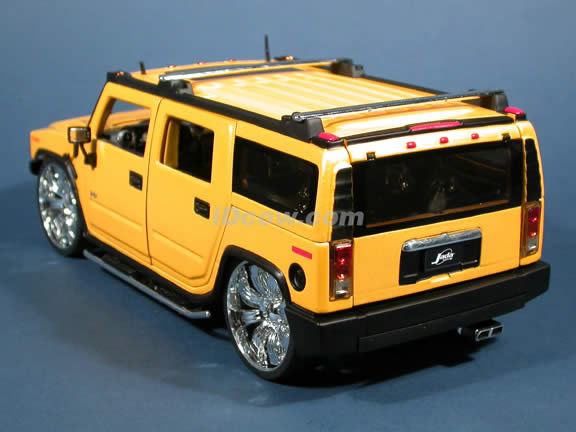 2004 Hummer H2 diecast model SUV with Spintek EVO-H Wheels 1:18 scale die cast from Dub City Jada Toys - Yellow