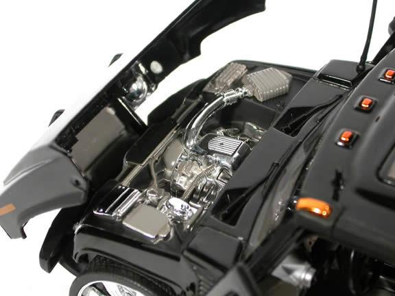 2004 Hummer H2 diecast model SUV with Spintek EVO-H Wheels 1:18 scale die cast from Dub City Jada Toys - Black