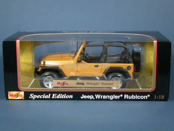 2004 Jeep Wrangler Rubicon diecast model car 1:18 scale die cast by Maisto - Gold