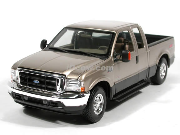 2004 Ford F-350 Lariat diecast model truck 1:18 scale die cast by Maisto - Gold and Black